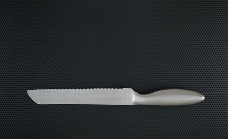 black metallic background: Kitchen cutting board and knife