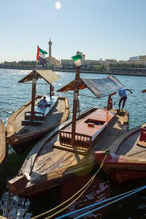 ferries: DUBAI, UAE-NOVEMBER 18, 2012: Traditional Abra ferries at the creek Editorial