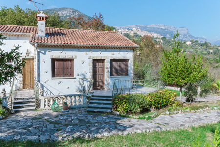 slate roof: Little white house with a slate roof in Provence, France Editorial
