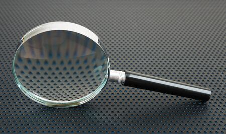 perforation: Magnifying glass on a metallic background with perforation of round holes
