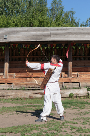 russian man: SAMARA, RUSSIA - MAY 28, 2014: Russian man in national dress archery Editorial