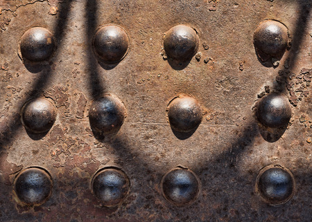 solidity: Old rusty metal rivets on the truss Stock Photo