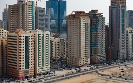 sharjah: SHARJAH, UAE - OCTOBER 29,  2013: Modern buildings in Sharjah. It is the most industrialized emirate in UAE. Editorial