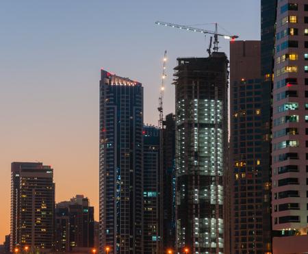 persian gulf: DUBAI, UAE - NOVEMBER 16: Modern buildings in Dubai Marina at night, on November 16, 2012, Dubai, UAE. In the city of artificial channel length of 3 kilometers along the Persian Gulf.