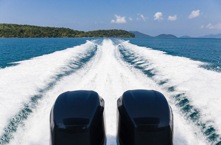 astern: Wake of speed boat in the tropical sea