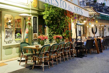 october 31: MOUGINS, FRANCE - OCTOBER 31, 2014: Street cafe at night