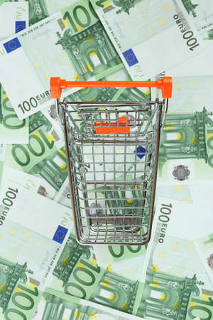 euro banknotes: Shopping cart on Euro banknotes