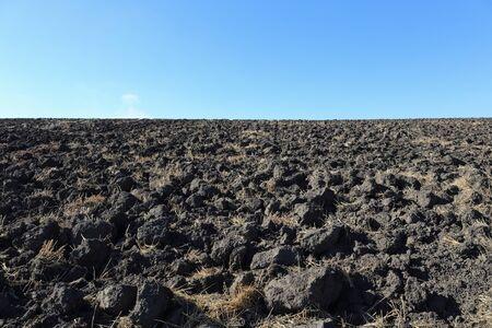 plowed: Plowed field in the countryside