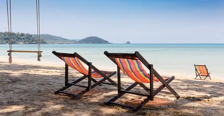 idyllic: Beach chairs on idyllic tropical sand beach.