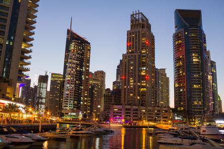 persian gulf: DUBAI, UAE - NOVEMBER 16: Night view Yacht Club in Dubai Marina, on November 16, 2012, Dubai, UAE. In the city of artificial channel length of 3 kilometers along the Persian Gulf.