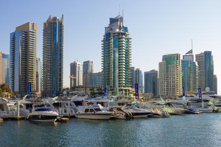 persian gulf: DUBAI, UAE - NOVEMBER 16: Yacht Club in Dubai Marina, on November 16, 2012, Dubai, UAE. In the city of artificial channel length of 3 kilometers along the Persian Gulf.