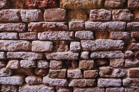 dilapidated: Old dilapidated brick wall close-up