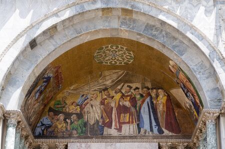 patriarchal: VENICE, ITALY - 26 JUNE, 2014: Frescoes on the front of basilica. Patriarchal Cathedral Basilica of Saint Mark is cathedral church of Roman Catholic Archdiocese of Venice.