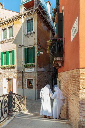 nuns: VENICE, ITALY - JUNE 26, 2014: Two Nuns on the street in Venice in Italy