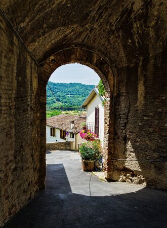 passageway: An arched passageway in the old Italian city