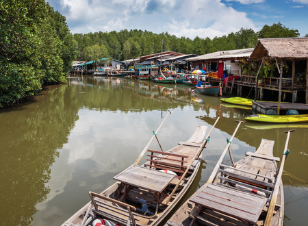 thickets: Old wooden boat in the fishing village of Thailand Stock Photo