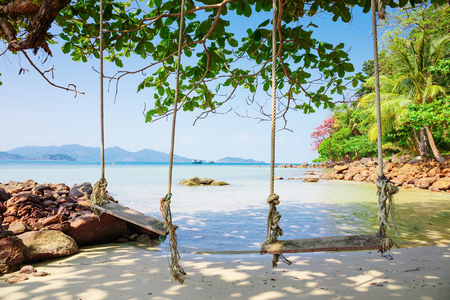 seesaw: Seesaw on the beach of a tropical island