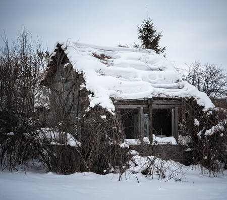 dilapidated: Old dilapidated farmhouse in winter