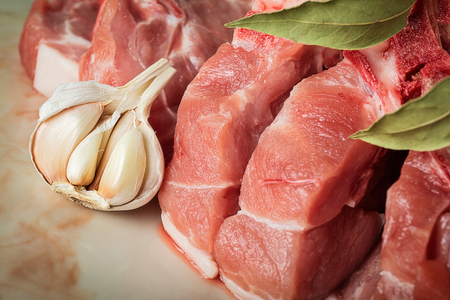 Chopped pork on a marble countertop in the kitchen Stock Photo