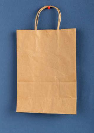 brown paper bag: Brown paper bag  on a blue background