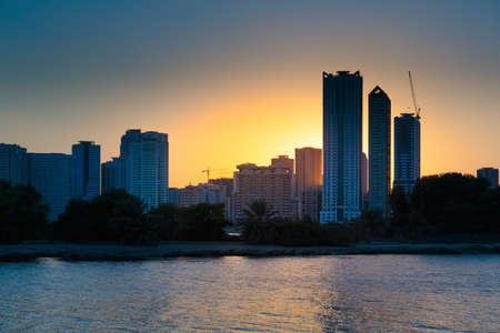 sharjah: SHARJAH, UAE - NOVEMBER 6: Night view of Sharjah, on November 6, 2013. Sharjah is located along northern coast of Persian Gulf on Arabian Peninsula