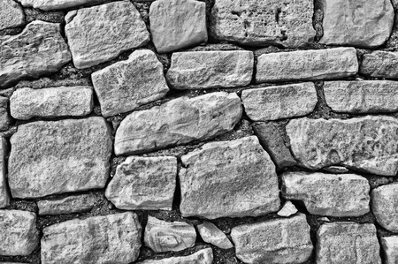 stones: stone wall of large stones, black and white