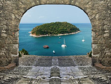 stone arch: View of the tropical island through the stone arch