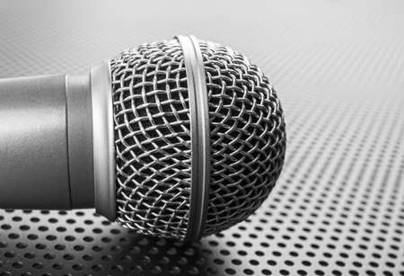 perforated: Classic dynamic microphone on black background  perforated
