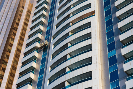 fastest: DUBAI, UAE - NOVEMBER 9, 2013: Modern buildings. Dubai was the fastest developing city in the world between 2002 and 2008.