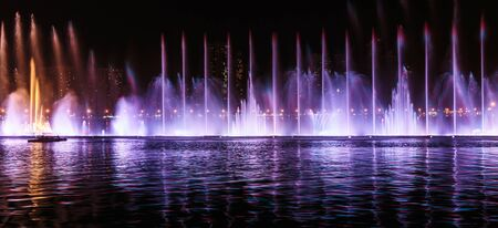 sharjah: SHARJAH, UAE - OCTOBER 29, 2013: Musical fountain show. The Sharjah Fountain is one of the biggest fountains in the region.