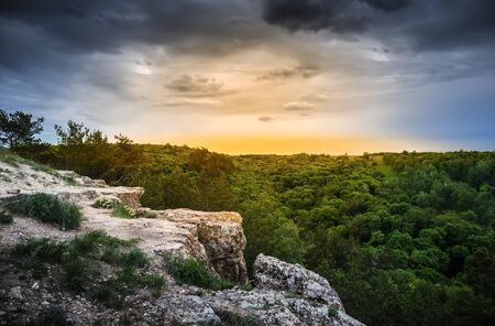 ledge: Rock ledge in the wooded mountains at sunrise