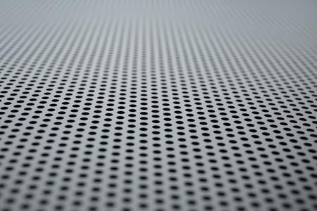 shiny black: Metallic background with perforation of round holes