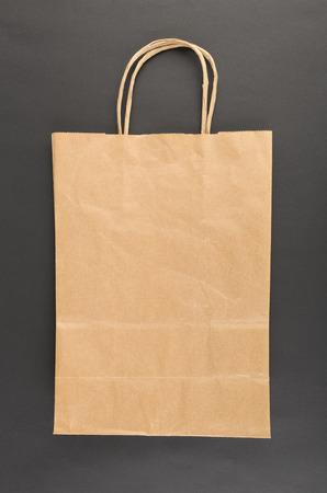brown paper bag: Brown paper bag  on a black background