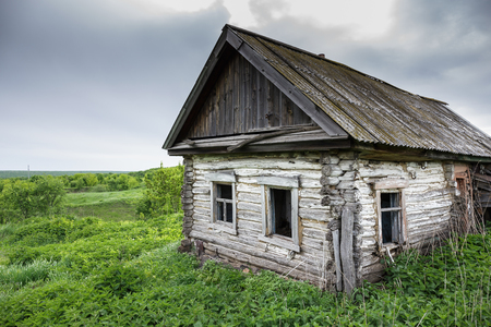 tacky: Dilapidated old wooden rustic house in Russia