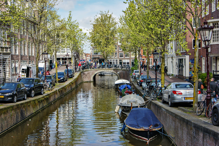 AMSTERDAM, NETHERLANDS - MAY 1, 2015: General view of a canal with boats