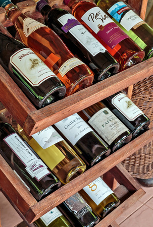collectible: PATTAYA, THAILAND - APRIL 2, 2015: Collectible French wines in the wine shelf in a restaurant