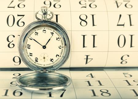 pocket watch: Old pocket watch on the calendar
