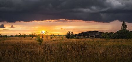 Sunset in a field in the countryside Stock Photo