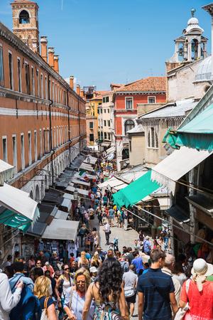 rialto: VENICE, ITALY - 26 JUNE, 2014: Crowds of tourists on the Rialto bridge in Venice