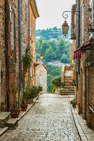 archways: Deserted street in old village Tourrettes-sur-Loup in France.