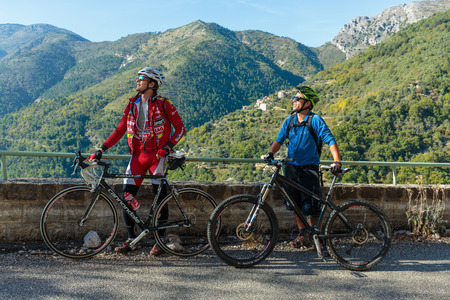maritimes: MONACO - NOVEMBER 1, 2014: Cyclists on a mountain road in the Alpes-Maritimes Editorial