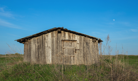 Old dilapidated barn in the field