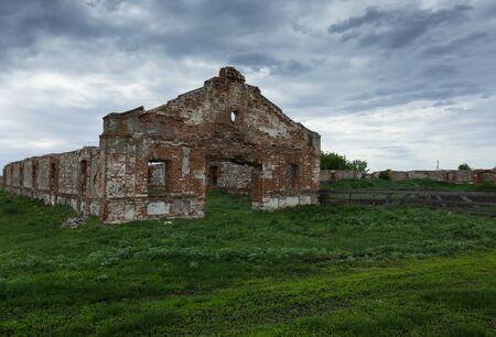 Old dilapidated brick abandoned barn Stock Photo
