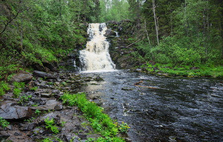 Picturesque landscape with a waterfall in the forest of Karelia, Russia