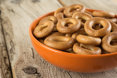Bagels in a bowl on an old wooden table