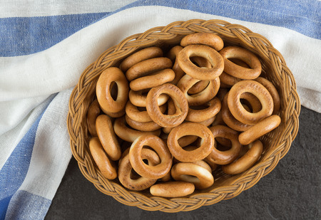Bagels in a basket with napkin on the black table Stock Photo