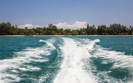 Wake of speed boat in the tropical sea