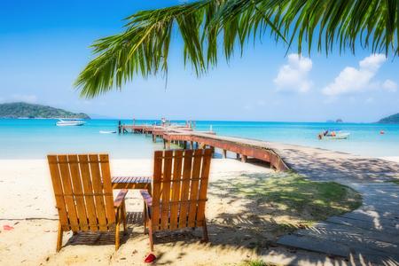 chairs: Two beach chairs on idyllic tropical sand beach.