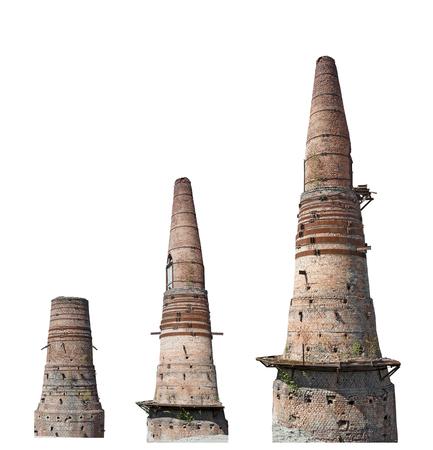 Old brick smokestack of factory isolated on white background, set Stock Photo