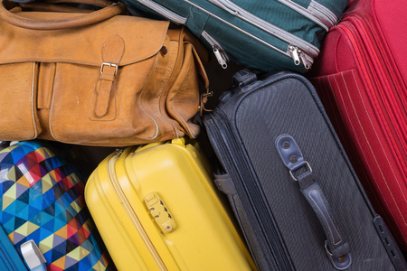 A stack of used suitcases Stock Photo